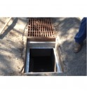 Storm drain screen removed for installation of STORM WATER PETRO BARRIER™.