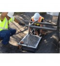 Lowering the StormWater Petro-Barrier™ into theDrain Housing