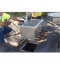 Installation of the StormWater Petro Barrier water filtration system directly in the pit