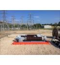 Isolateur et disjoncteurs à huile dans un bac de stockage temporaire TRFLEX sur chantier haute tension