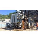 Transformador EDF con foso de piedras antes de la limpieza y puesta en conformidad incendio EXTICOV SAERGRID